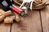 Wine bottle with corks and corkscrew — Stock Photo