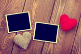 Photo frames and toy hearts — Stock Photo