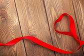 Heart shape ribbon over wood valentines day background — Stock Photo