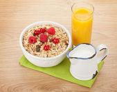Healty breakfast with muesli, berries, milk and orange juice — Stock Photo