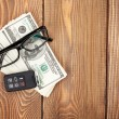 Money cash, glasses and car remote key on wooden table — Stock Photo #64037041