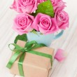 Valentines day pink roses bouquet and gift box — Stock Photo #64037511
