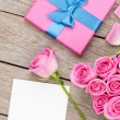Pink roses and valentines day greeting card — Stock Photo #64037609