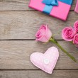 Valentines day background with gift box full of pink roses — Stock Photo #64037621