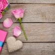 Valentines day background with gift box full of pink roses — Stock Photo #64037639