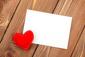 Photo frame or greeting card and handmaded toy heart — Stock Photo