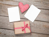 Valentines day toy heart, blank photo frames and gift box — Stock Photo