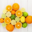 Citrus fruits. Oranges, limes and lemons — Stock Photo #64597783