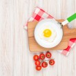 Healthy breakfast with fried egg and tomatoes — Stock Photo #64597815