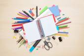 Blank notepad over school and office supplies — Stockfoto