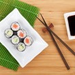 Постер, плакат: Sushi maki set and soy sauce