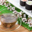 Постер, плакат: Green tea and sushi maki set