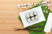 Sushi maki with cucumber and sakura branch — Stock Photo
