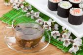 Green tea and sushi maki set — Stock Photo