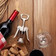 Red wine, bottle and corkscrew — Stock Photo #66384505