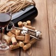 Red wine, bottle and corkscrew — Stock Photo #66384843