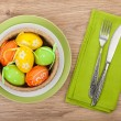 Easter eggs nest on plate — Stock Photo #66384899