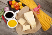 Parmesan cheese, pasta, tomatoes, vinegar — Stock Photo