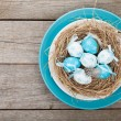 Easter eggs nest on plate — Stock Photo #67057365
