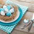 Easter eggs nest  with silverware — Stock Photo #67612271