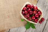 Ripe cherries on wooden table — Stock Photo