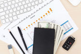 Office table with pc, supplies and money — Stock Photo
