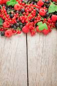 Ripe berries on wooden table — Stock Photo