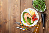 Grilled salmon, salad and condiments — Stock Photo