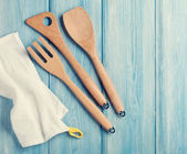 Kitchen cooking utensils over wooden table — Stock Photo