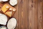 Sour cream, milk, cheese, eggs — Stock Photo