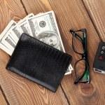 Money cash, glasses and car  key — Stock Photo #71509679