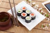 Sushi maki set, and green tea — Stock Photo