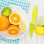 Citrus fruits. Oranges, limes and lemons — Stock Photo #72080647
