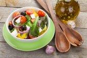 Fresh healty salad and kitchen utensils — Stock Photo