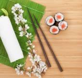 Sushi maki set with sakura branch — Stock Photo