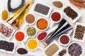 Various spices on white wooden background — Stock Photo
