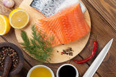 Salmon, spices and condiments — Stock Photo