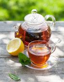 Breakfast tea on table in garden — Stock Photo