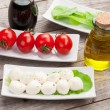 Tomatoes, mozzarella and green salad leaves — Stock Photo #74206807