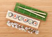 Sushi maki set with fresh sakura branch — Stock Photo