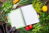 Fresh garden herbs and notepad for recipes — Stock Photo