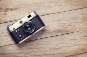 Vintage camera on wooden table — Stock Photo