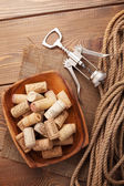 Bowl with wine corks and corkscrew — Stock Photo