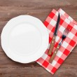 Empty plate and silverware over table — Stock Photo #78739034