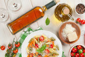 Colorful pasta and and white wine — Stock Photo