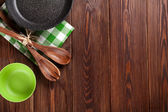 Cooking utensil on wooden table — Stock Photo