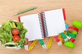 Dumbells, tape measure, healthy food — Stock Photo