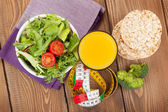 Healthy food and tape measure — Stock Photo