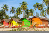 Colorful huts on the sandy beach — Stock Photo