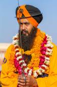Sikh devotee with orange turban — Stock Photo